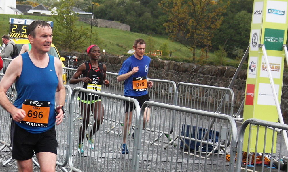 Racing for the finish line with Juliet Champion, 3rd female at Stirling Marathon